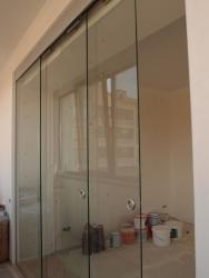 Двустворчатые раздвижные стеклянные двери межкомнатные